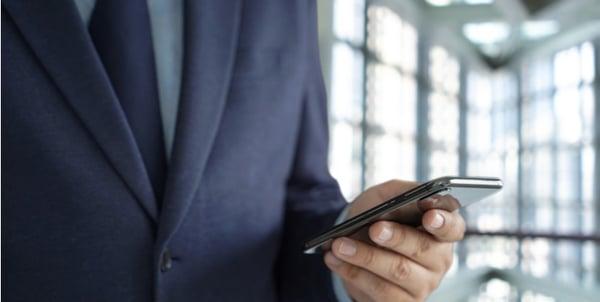 business man using app on phone